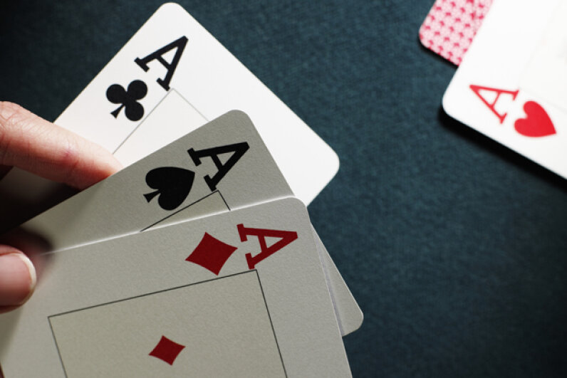 "The phrase ""palm off"" came from deception while playing cards. Michael Blann/Digital Vision/Thinkstock"