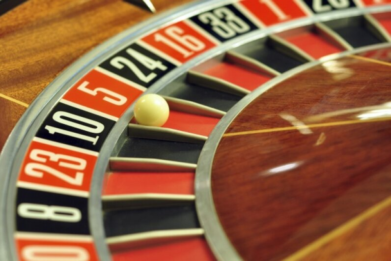 If red just came up seven times in a row on the roulette wheel, would you be more likely to bet on red or black before that eighth turn? tony4urban/iStock/Thinkstock