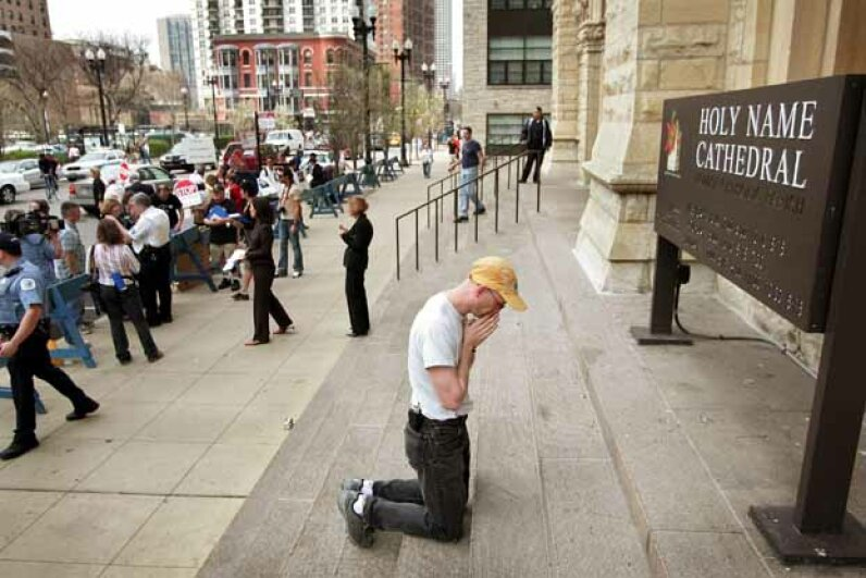 Mark Zak kneels to pray outside Holy Name Cathedral in Chicago during a demonstration calling for Cardinal Francis George to resign following his failure to take immediate action a priest charged of sexually abusing three boys. Scott Olson/Getty Images