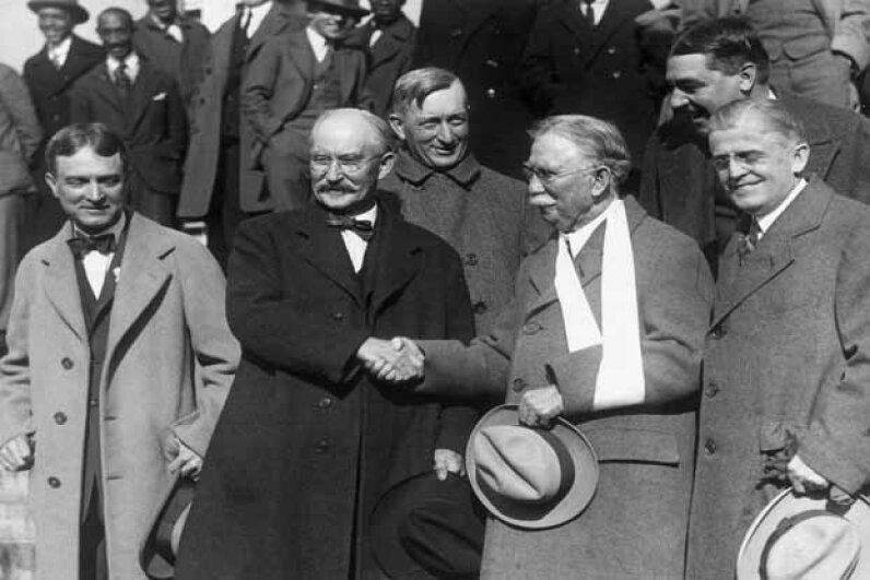 Former U.S. Secretary of the Interior Albert Fall (2nd from left) shakes hands with American oil magnate Edward Doheny, flanked by their lawyers, after their acquittal during the Teapot Dome scandal. Fall was subsequently sentenced. Hulton Archive/Getty Images