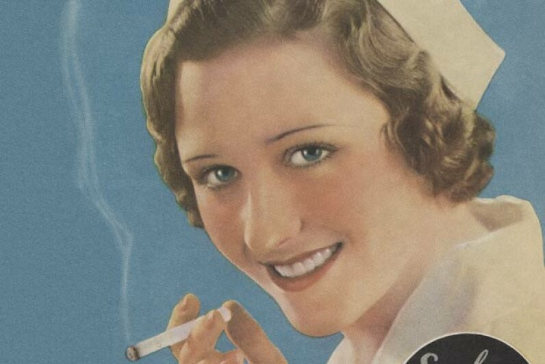 A 1930's magazine ad shows a nurse enjoying a cigarette. © Blue Lantern Studio/Corbis