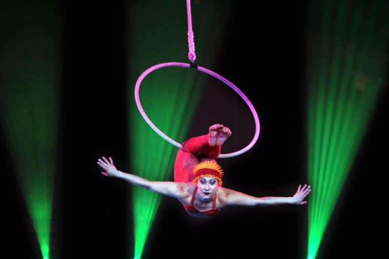 Acrobats like this aerial hoop artist perform daring stunts that require strength, skill and a lot of bravery. Robert Pearce/Fairfax Media/Fairfax Media via Getty Images