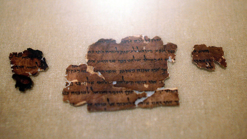 """A 2,000-year-old fragment from the Dead Sea Scrolls is seen on display at The Jewish Museum in New York City in the 2008 exhibit """"The Dead Sea Scrolls: Mysteries of the Ancient World."""" Chris Hondros/Getty Images"""
