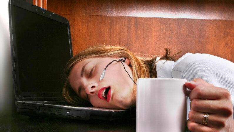 woman at computer asleep