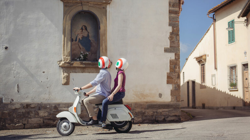 couple on moped in Italy