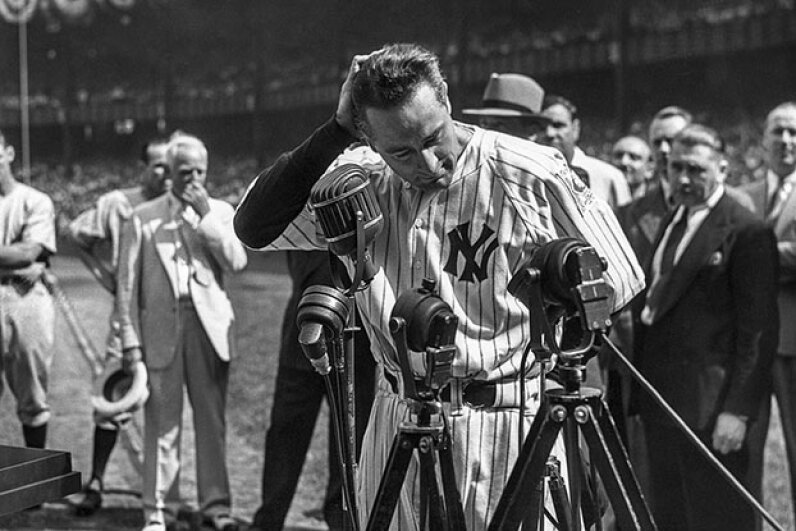 Lou Gehrig is shown before the mic delivering his famous farewell speech on Lou Gehrig Day, July 4, 1939, at Yankee Stadium in the Bronx, New York. Stanley Weston/Getty Images