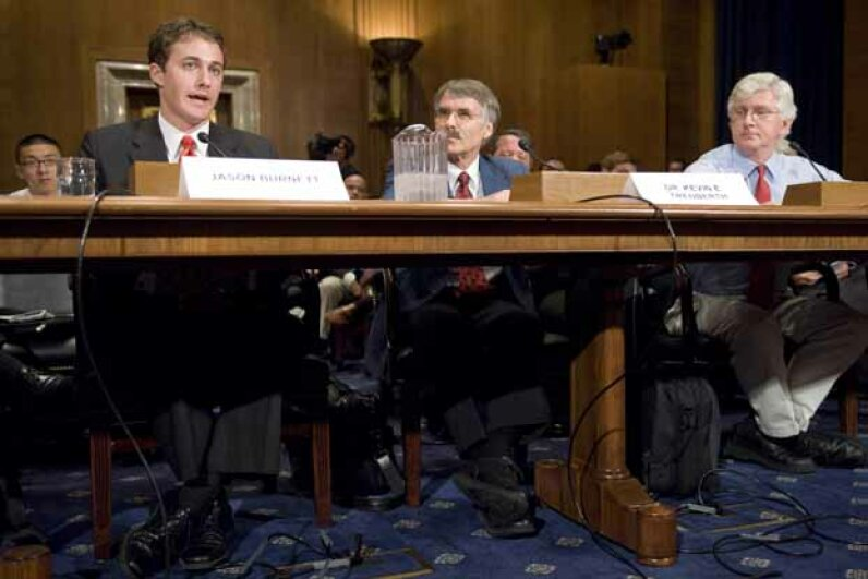 From left, Jason Burnett of the EPA; Kevin Trenberth, head of climate analysis at the National Center for Atmospheric Research; and Roy Spencer, a research scientist at the University of Alabama, testify at a 2008 senate hearing on global warming. Bill Clark/Roll Call/Getty Images