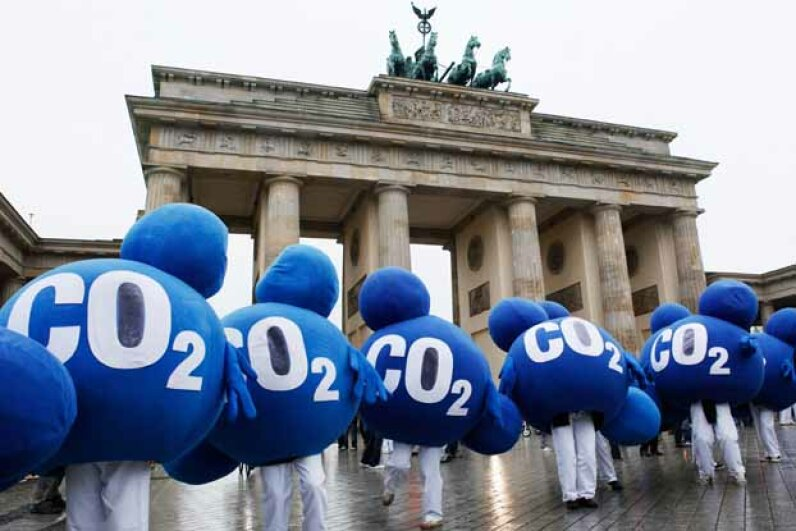 Environmental activists dressed up as CO2 molecules stage a protest in front of Berlin's landmark Brandenburg Gate in 2009 to coincide with the United Nations Climate Change Conference in Copenhagen. DAVID GANNON/AFP/Getty Images