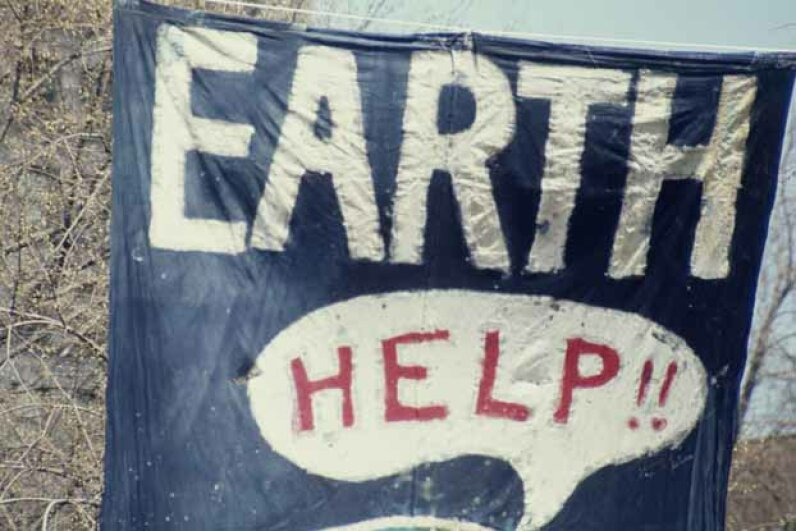 A banner flies at the inaugural Earth Day, New York City, in 1970. Did scientists back then really believe global cooling was coming? Archive Photos/Getty Images