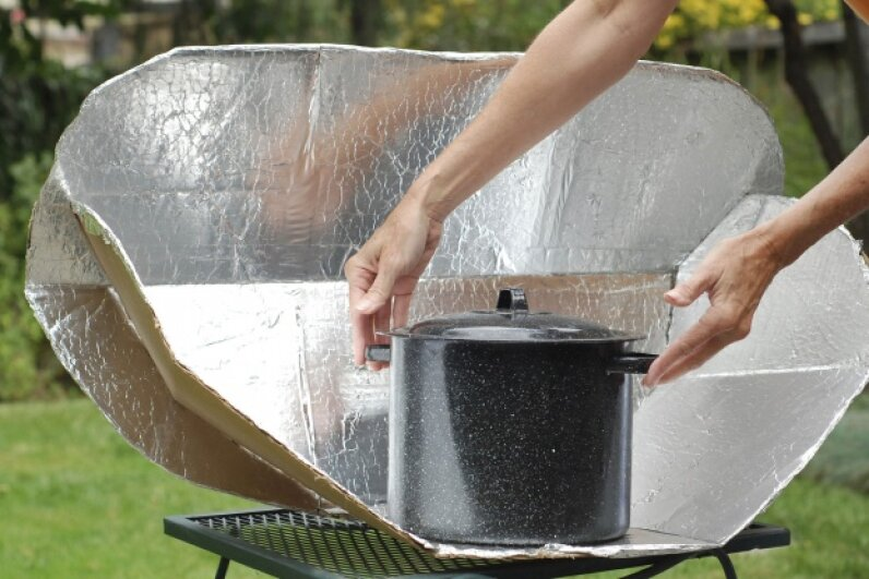 Building a solar cooker is a simple task and requires common household supplies. © ckellyphoto/iStock/Thinkstock