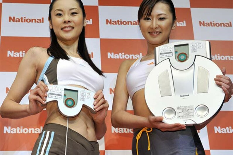Models display a body composition monitor equipped with an optical subcutaneous-fat scanner that measures a user's weight and body-mass index (BMI) among other features. Doctors have changed their minds about BMI measurement in the 21st century. See heart health pictures. YOSHIKAZU TSUNO/AFP/Getty Images