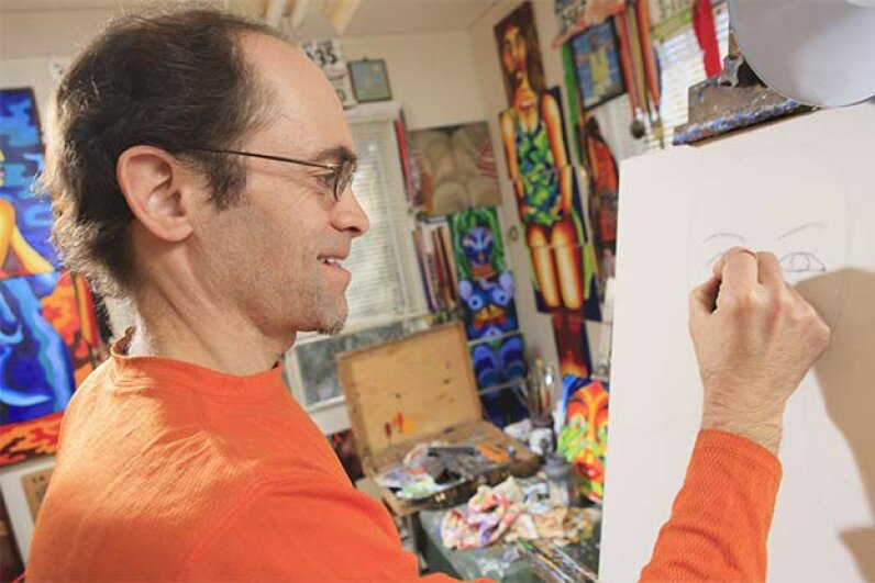 """This man with Asperger's syndrome outlines a picture in his studio. Asperger's used to be considered a separate disorder from autism but the 2013 DSM merges them together under the """"autism spectrum disorder"""" category. Huntstock/Getty Images"""