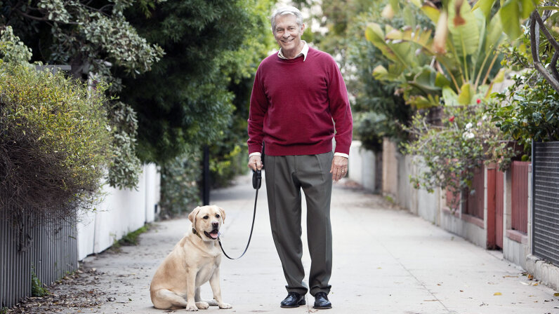 senior walking dog