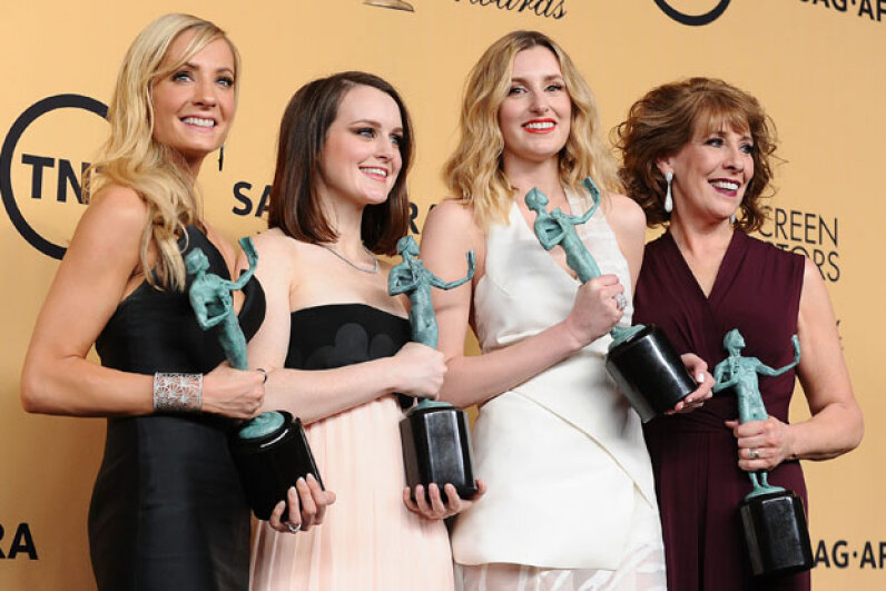 (L-R) Actresses Joanne Froggatt, Sophie McShera, Laura Carmichael, and Phyllis Logan, winners of Outstanding Performance by an Ensemble in a Drama Series for 'Downton Abbey,' at the 21st annual Screen Actors Guild Awards in January 2015. Jason LaVeris/FilmMagic/Getty Images