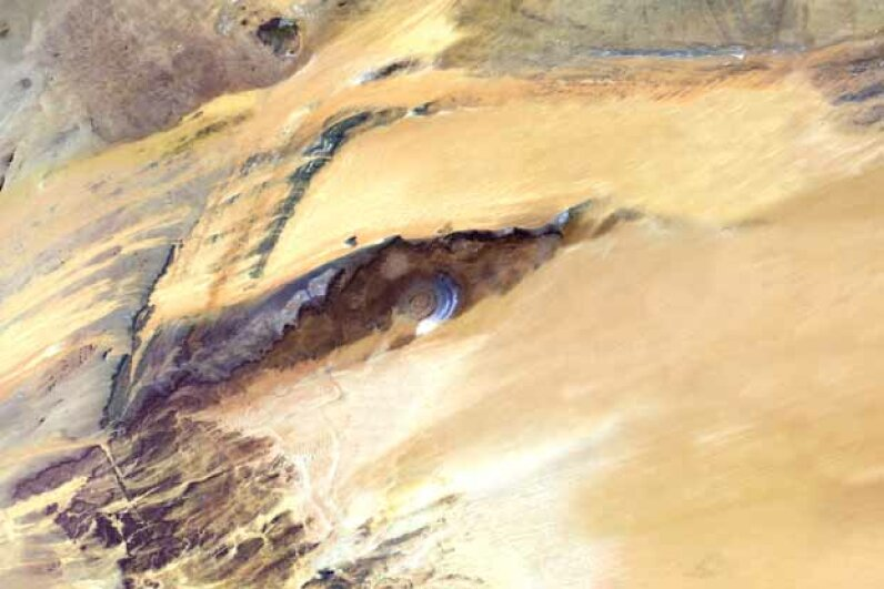 This satellite image shows the Richat Structure. Although it resembles an impact crater, the Richat Structure formed when a volcanic dome hardened and gradually eroded, exposing the onion-like layers of rock. Planet Observer/Universal Images Group via Getty Images
