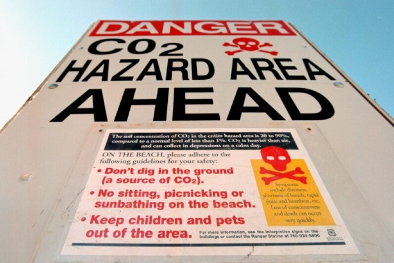 Carbon dioxide danger signs were posted at Horseshoe Lake on the southeast side of Mammoth Mountain near Mammoth Lakes, California in June 2000. © David McNew/Newsmaker