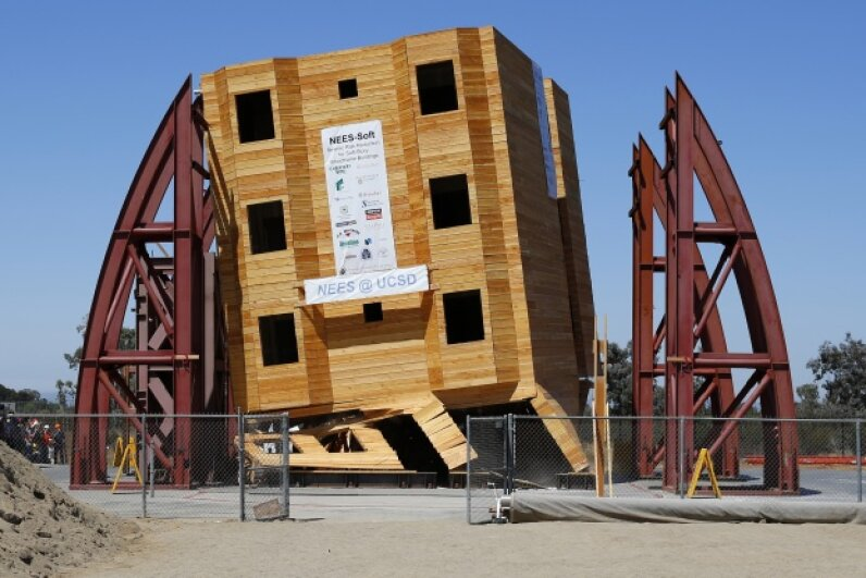 A four-story wood frame building is tested under the conditions of a number of historical earthquakes using the world's largest outdoor shake table by researchers at the University of San Diego California on Aug. 17, 2013. © Mike Blake/Reuters/Corbis