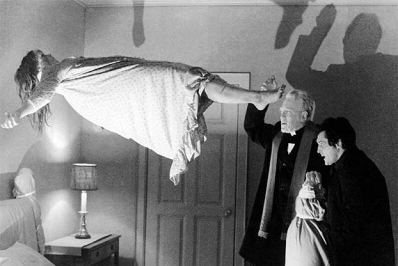 Max von Sydow (center) as Father Merrin, and Jason Miller as Father Karras perform an exorcism on Regan MacNeil (played by Linda Blair) in 'The Exorcist.' Silver Screen Collection/Getty Images