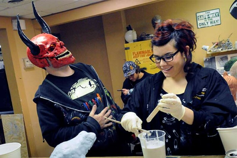 Instructor Shawn Ronzio of Tom Savini's Special Effects Program in Pittsburgh shares a laugh with student Alana Schiro at a sculpture class in 2010. Savini has run this program, which teaches movie make-up effects, since 2000. © Pittsburgh Post-Gazette/ZUMA Press/Corbis