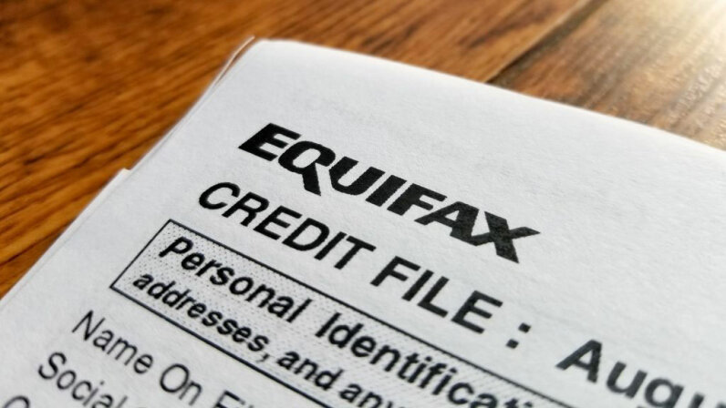 A close-up of a credit report from Equifax. In September 2017, a data breach at Equifax exposed the personal information of thousands of customers. Smith Collection/Gado/Getty Images