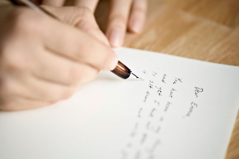 Take the time to write a note to someone in their time of grief.  © Eerik/iStockphoto