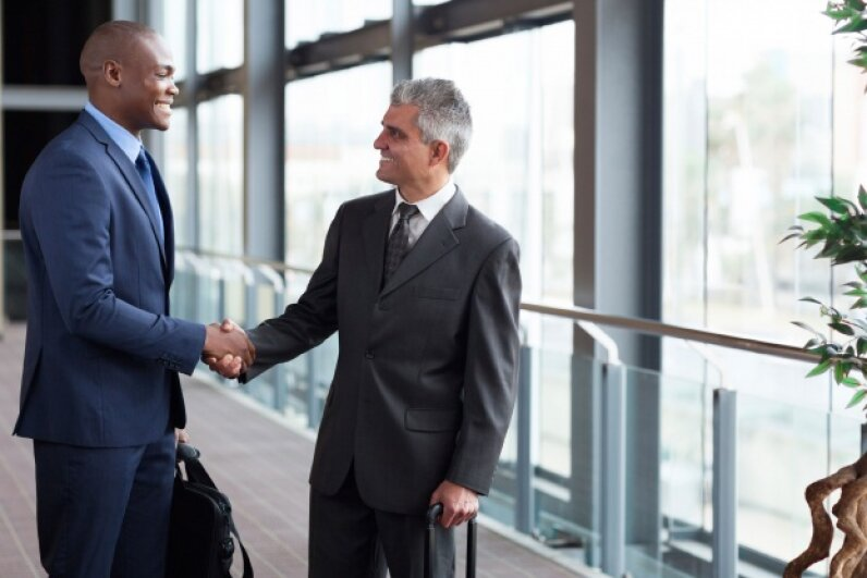 Introducing yourself, whether socially or in a business context, is best when you make eye contact with the person you're meeting. © michaeljung/iStockphoto