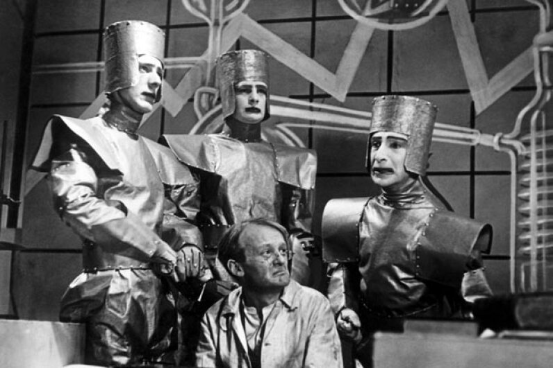 "A scene from a 1938 TV production of ""R.U.R."", or ""Rossum's Universal Robots,"" the play which introduced the term ""robot"" into many of the world's languages. BBC/Corbis"