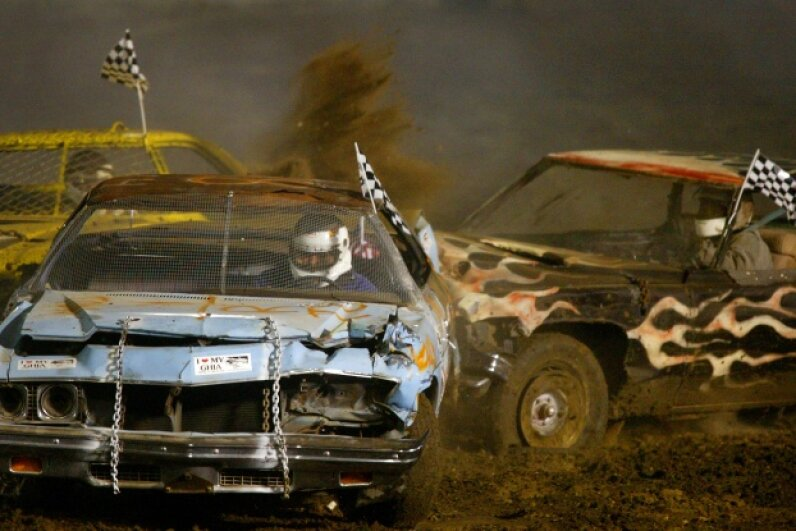 Don Clobes Jr. gets hit on both sides of his car at the Ventura County Fair Demolition Derby.