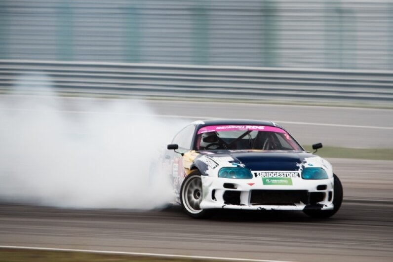Normally, driving your car sideways at high speeds would be a terrifying ordeal — but it's the rule in drifting. © Roma Yandolin/Demotix/Corbis