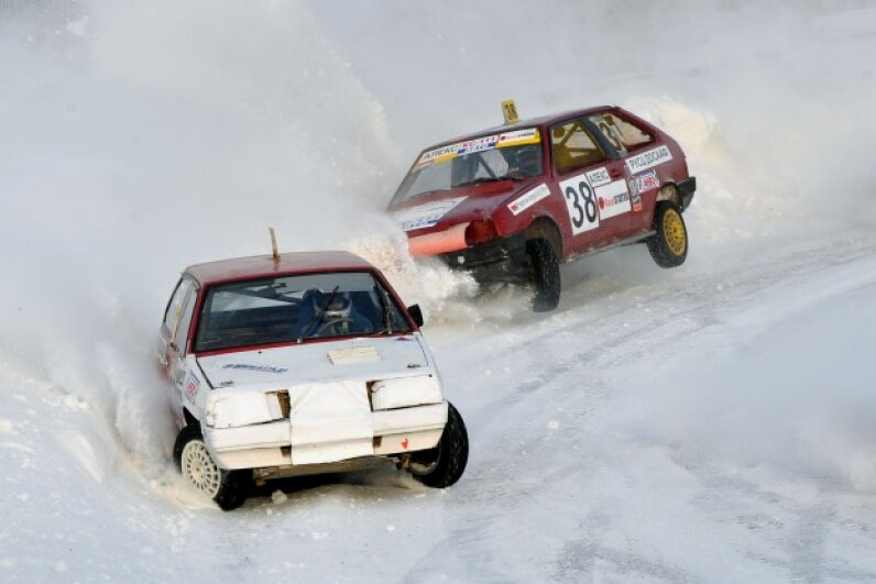 Driving on ice causes difficulty maintaining traction, but these racers are up for the challenge. VIKTOR DRACHEV/AFP/Getty Images