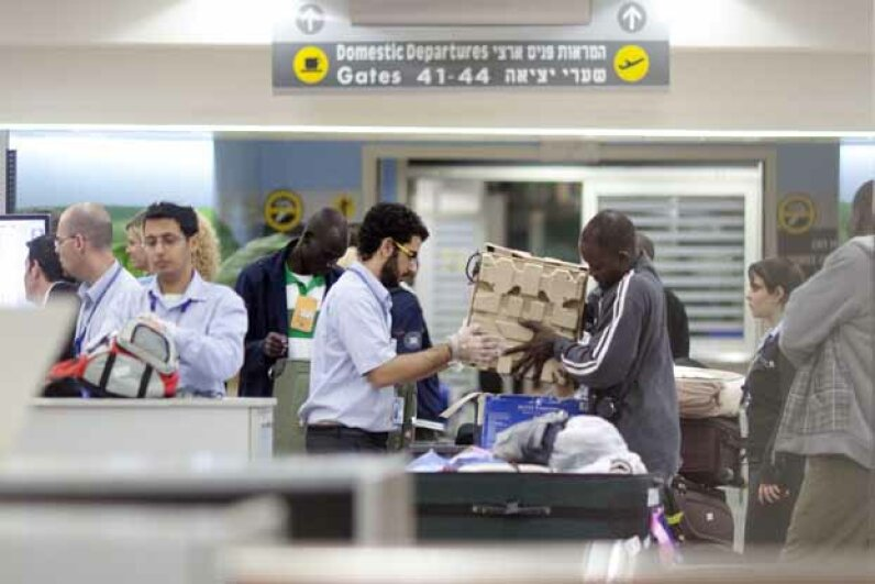 A man is screened during a security check at Ben-Gurion Airport in Israel.  Israeli airport security officials are famous for the techniques they use to question passengers before a flight. Uriel Sinai/Getty Images