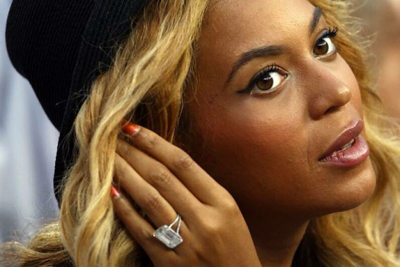 Beyonce flashes her engagement ring while watching the 2011 U.S. Open tennis championships. Reportedly the 18-carat diamond ring cost $5 million. Was that two months of Jay-Z's salary? Clive Brunskill/Getty Images