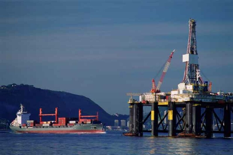 A freighter passes an oil drilling platform in Guanabara Bay, Rio de Janeiro, Brazil. Eduardo Garcia/Taxi/Getty Images
