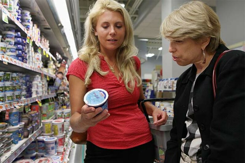 Dietician Jennifer Shea (L) from Shaw's/Star Market and Nora Saul, nutrition manager from Joslin Diabetes Center, look at the ingredients in yogurt at the store's location in Cambridge, Mass. Sometimes fat-free doesn't mean less calories. Wendy Maeda/The Boston Globe via Getty Images