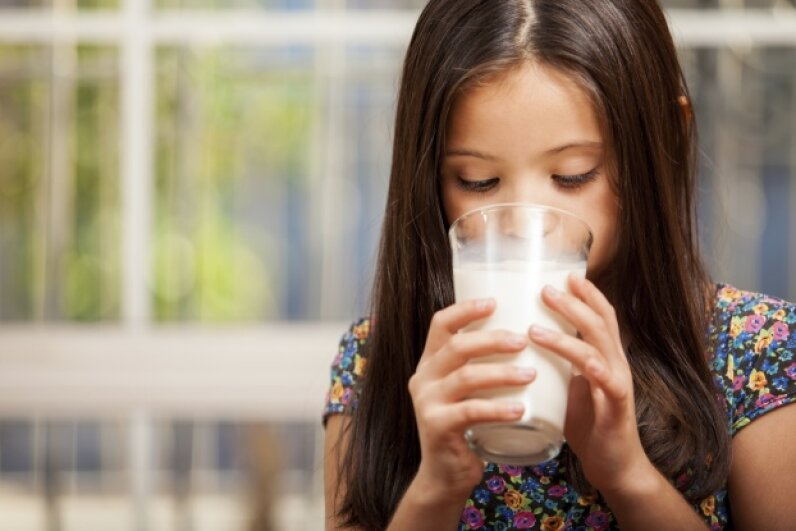 Is drinking milk going to make her taller? Not necessarily. Antonio Diaz/iStock/Thinkstock