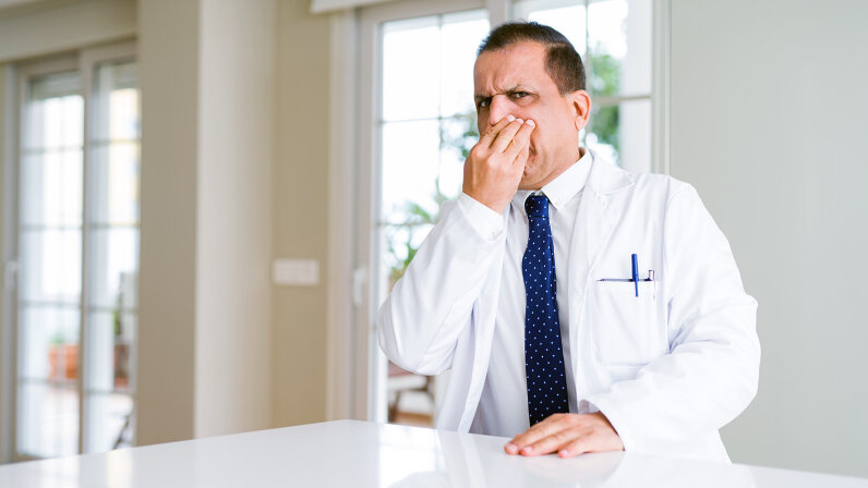 doctor smelling something stinky