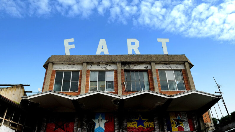FART spelled out on top of building