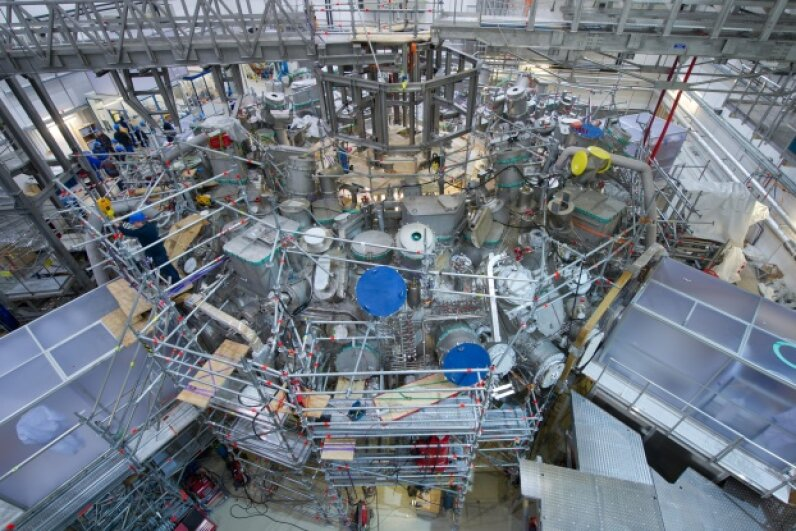 Nuclear fission may have fallen out of favor, but nuclear fusion has not. Mechanics work on the experimental nuclear fusion reactor 'Wendelstein 7-X' at Germany's Max Planck Institute of Plasma Physics (IPP) on Dec. 9, 2013. © Stefan Sauer/dpa/Corbis