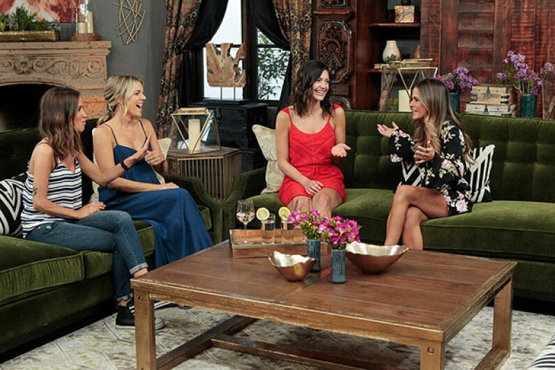 """JoJo Fletcher (right) gets advice from former bachelorettes in the """"Bachelorette mansion."""" That's where the cast is locked away without access to TV, internet, phone or reading material. No wonder fights break out. Rick Rowell/ABC via Getty Images"""
