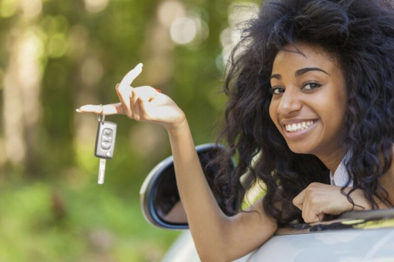 Part of preparing for your teen's first car is having a frank discussion with her about the expenses involved, and the responsibilities she'll have related to it. ©iStock/Thinkstock