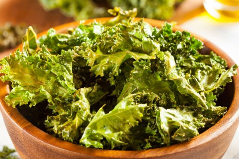 Kale is loaded with nutrients, but it can also give you a foul-smelling case of gas. ©bhofack2/iStock