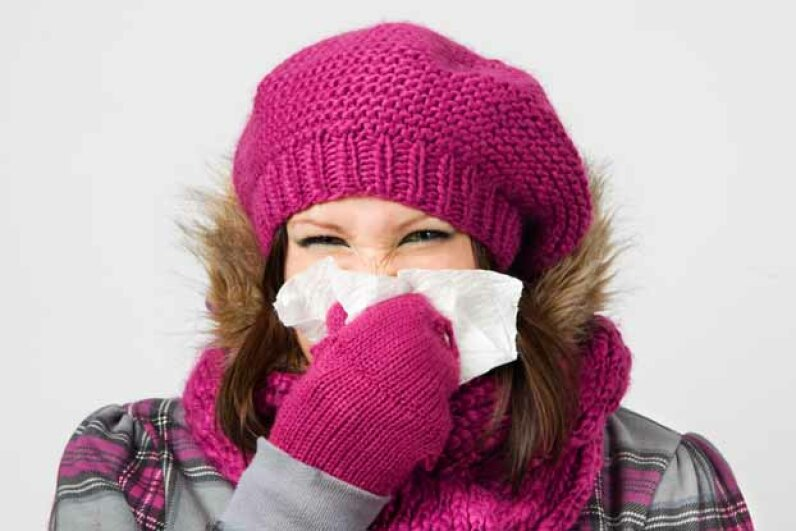 Though it makes sense to think that cold or wet weather makes you more likely to catch the flu, it is simply not true. E+/Thinkstock
