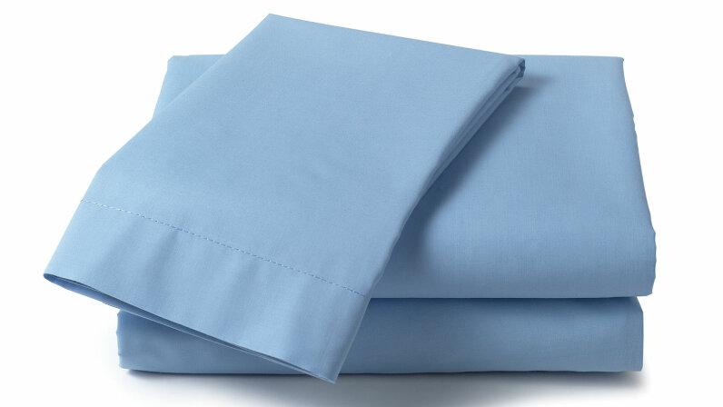 pile of blue folded sheets
