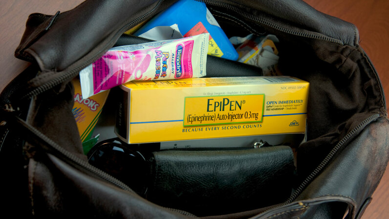 If you find out you have a severe food allergy, you should always travel with an emergency treatment like EpiPen. nkbimages/Getty Images