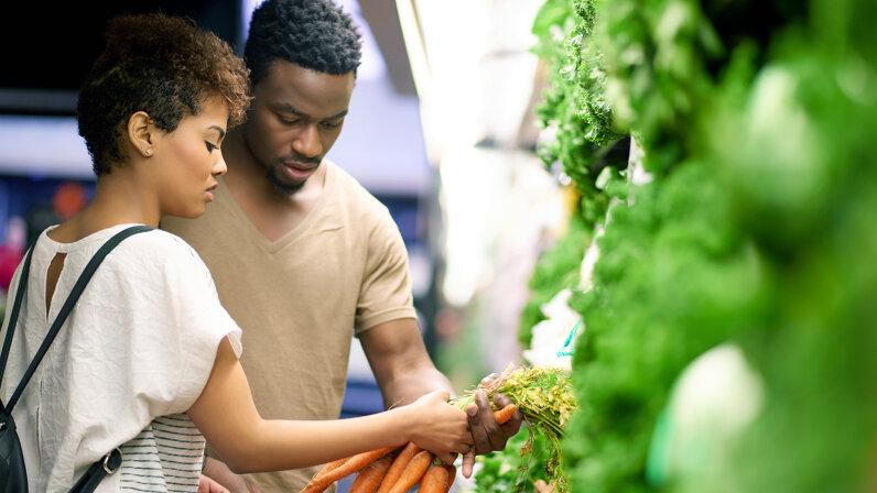 couple shopping for vegetables