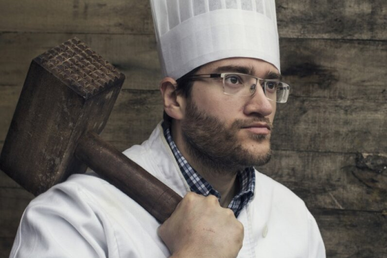 If you don't have some explosives handy for tenderizing your meat, you could always make do with an enormous wooden mallet. WIN-Initiative/Getty Images