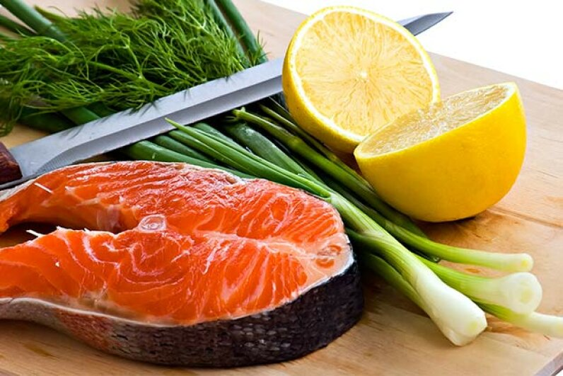 To avoid cross-contamination, have one cutting board for raw meat and fish and another for fruits and vegetables. Pavel Vlasov/Hemera/Thinkstock
