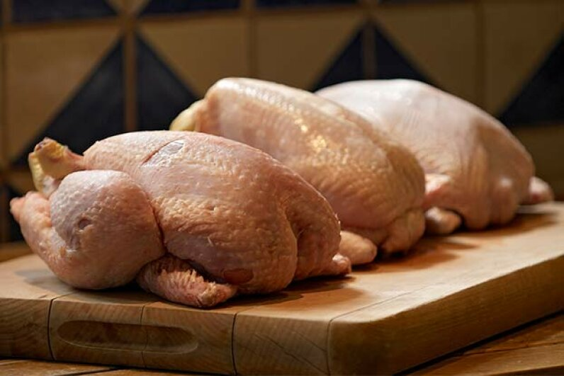 Thawing meat on the kitchen counter is not a good idea because bacteria can build up quickly. Peter Anderson/Thinkstock