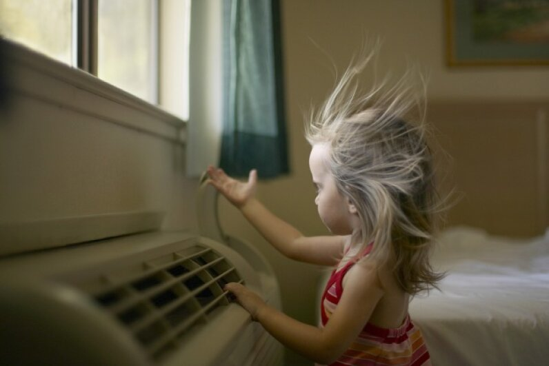 Air conditioning was a massive win over that hot, humid Mother Nature. Stephanie Rausser/The Image Bank/Getty Images