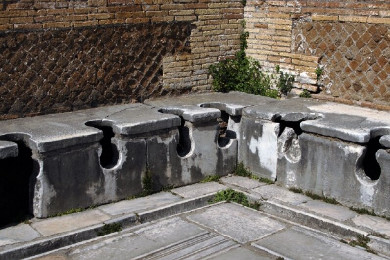 These second-century Roman latrines had water running beneath them to wash away waste.  Prisma/UIG via Getty Images